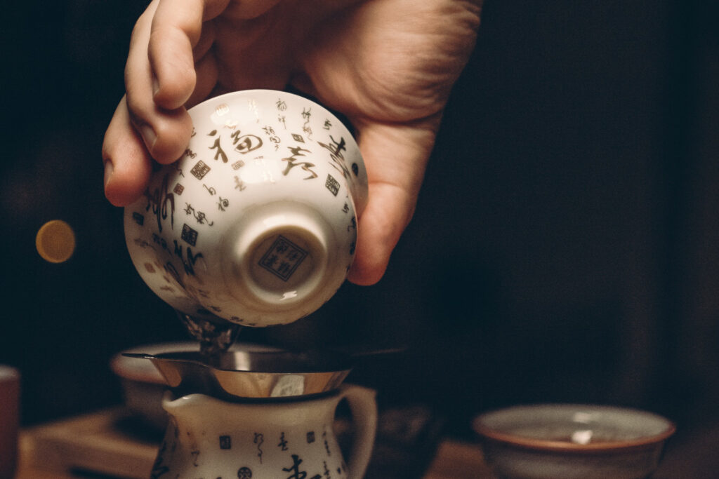 tea being poured in traditional tea cup