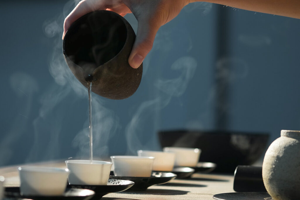 Tea being poured in traditional cups