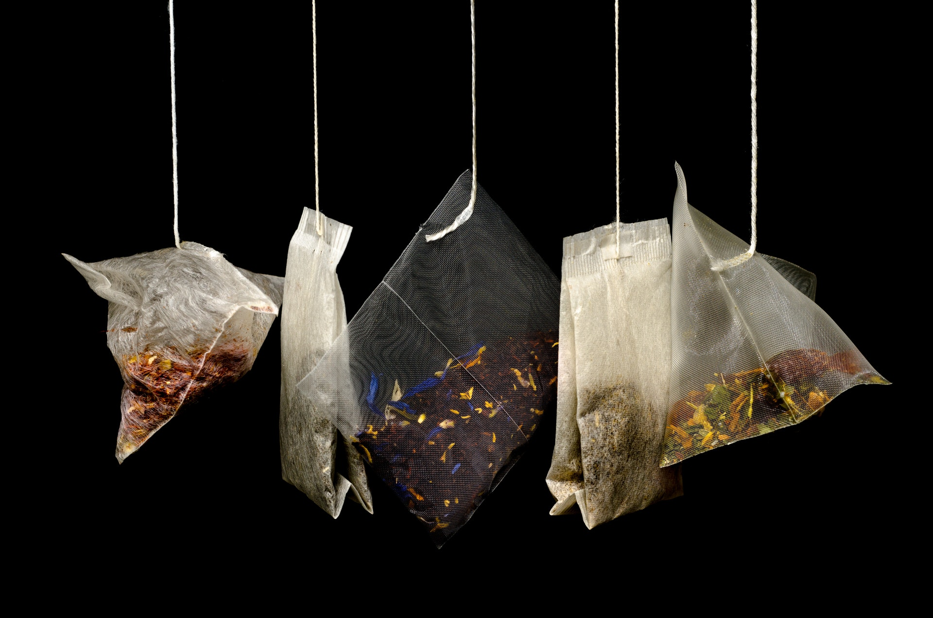 four different types of tea in teabags
