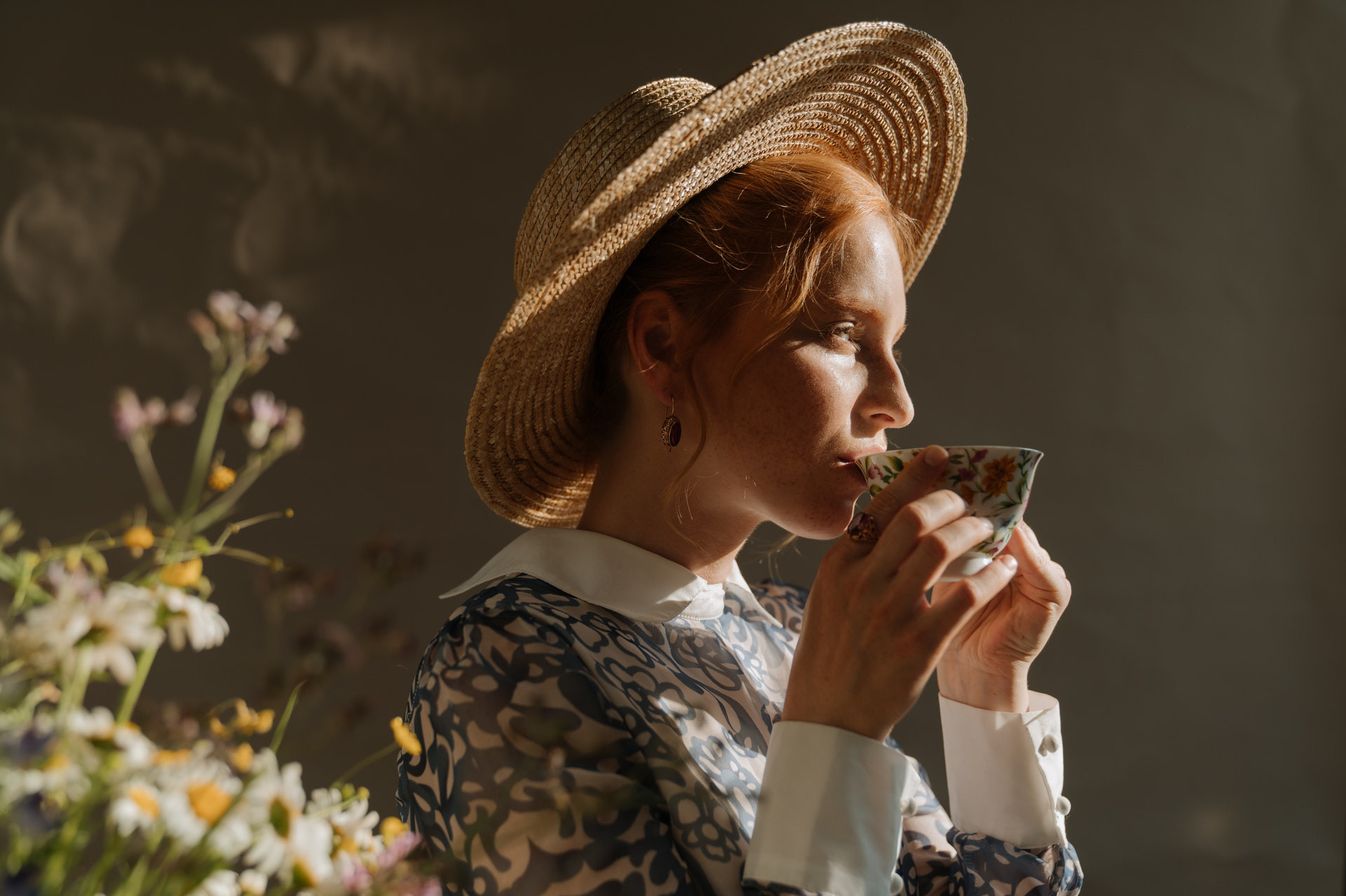 woman drinking tea from teacup